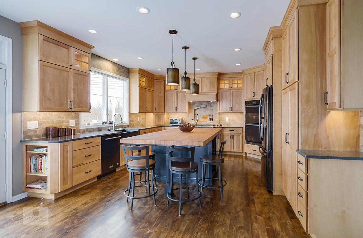 warm wood kitchen design with blue island