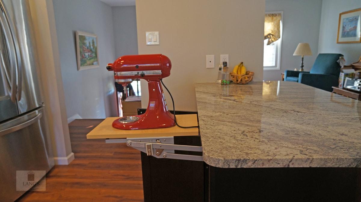 kitchen with appliance lift storage