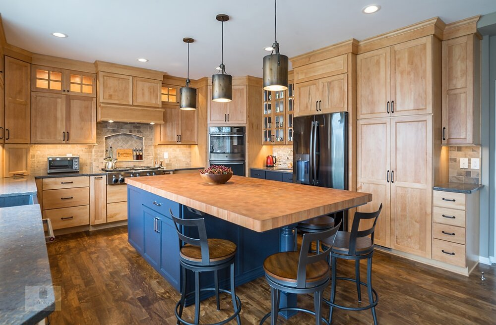 blue kitchen cabinets with wood countertop