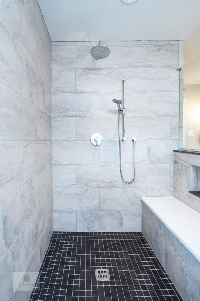 shower with tile floor and bench