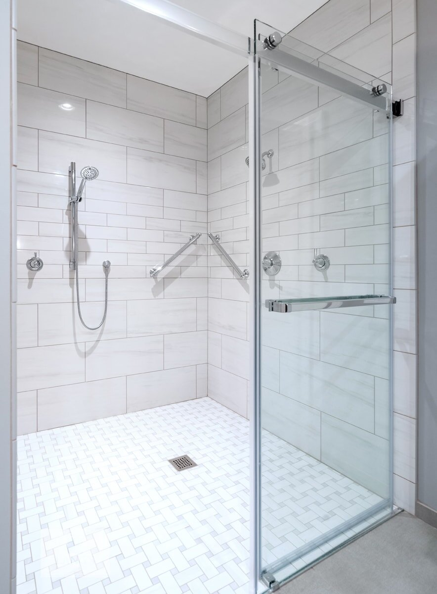 large shower design with grab bars