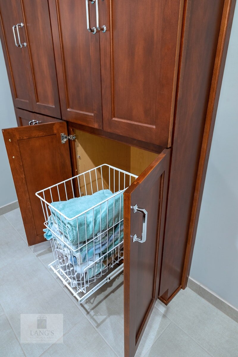 bath design with laundry hamper pull out
