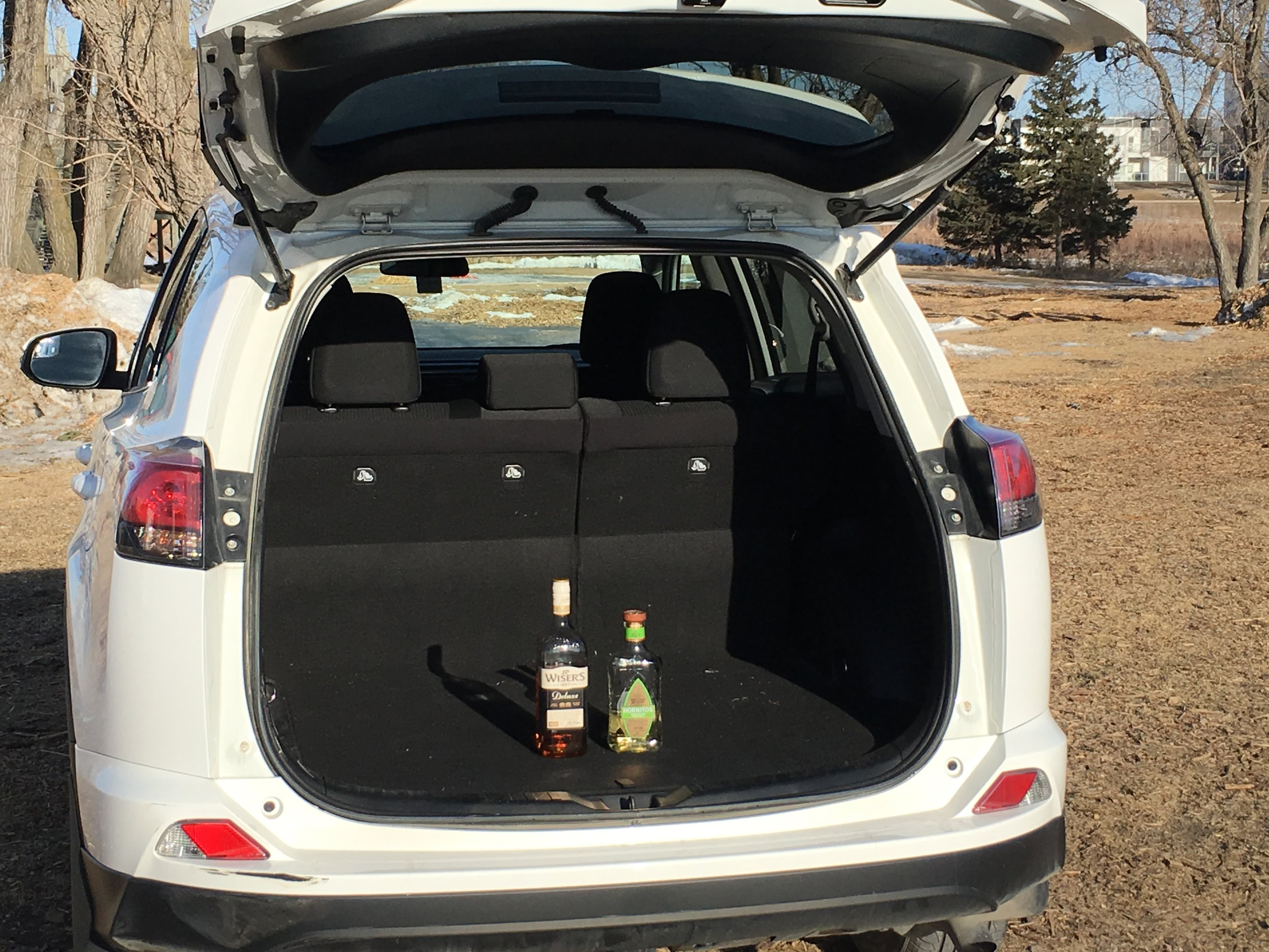 In a van or SUV - Store open liquor behind the last row of seats