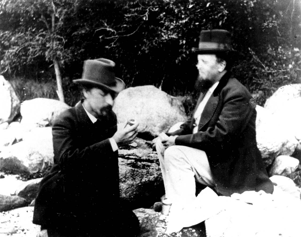 George Brainerd (left) having lunch with a friend in 1875 on the shore in Great Neck, Long Island. You might notice that there's some blurriness on their faces. The exposure time of the camera was likely less than a second, much better than the older wetcollodion process that would take several minutes to capture one shot, though not quite fast enough yet to capture motion. (Photo Credit: George Bradford Brainerd)