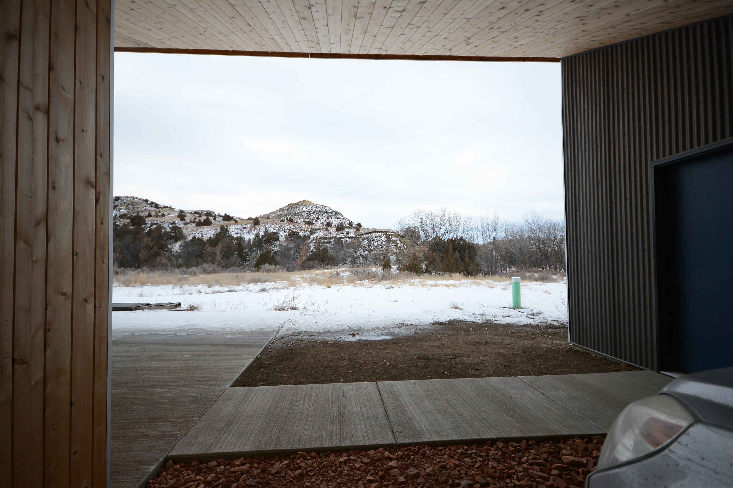 We separated the garage to allow for a carport/unloading zone, but also to capture the essence of the site.