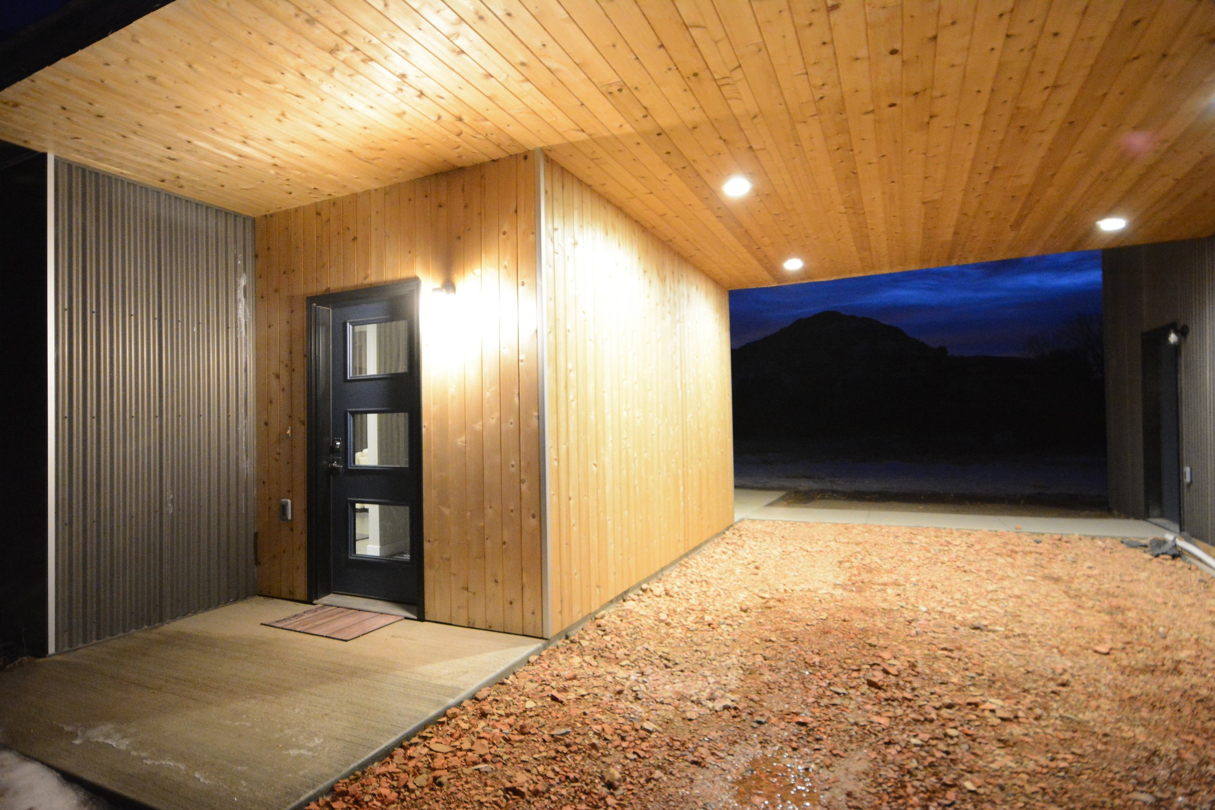The front door was placed next to the carport strategically.
