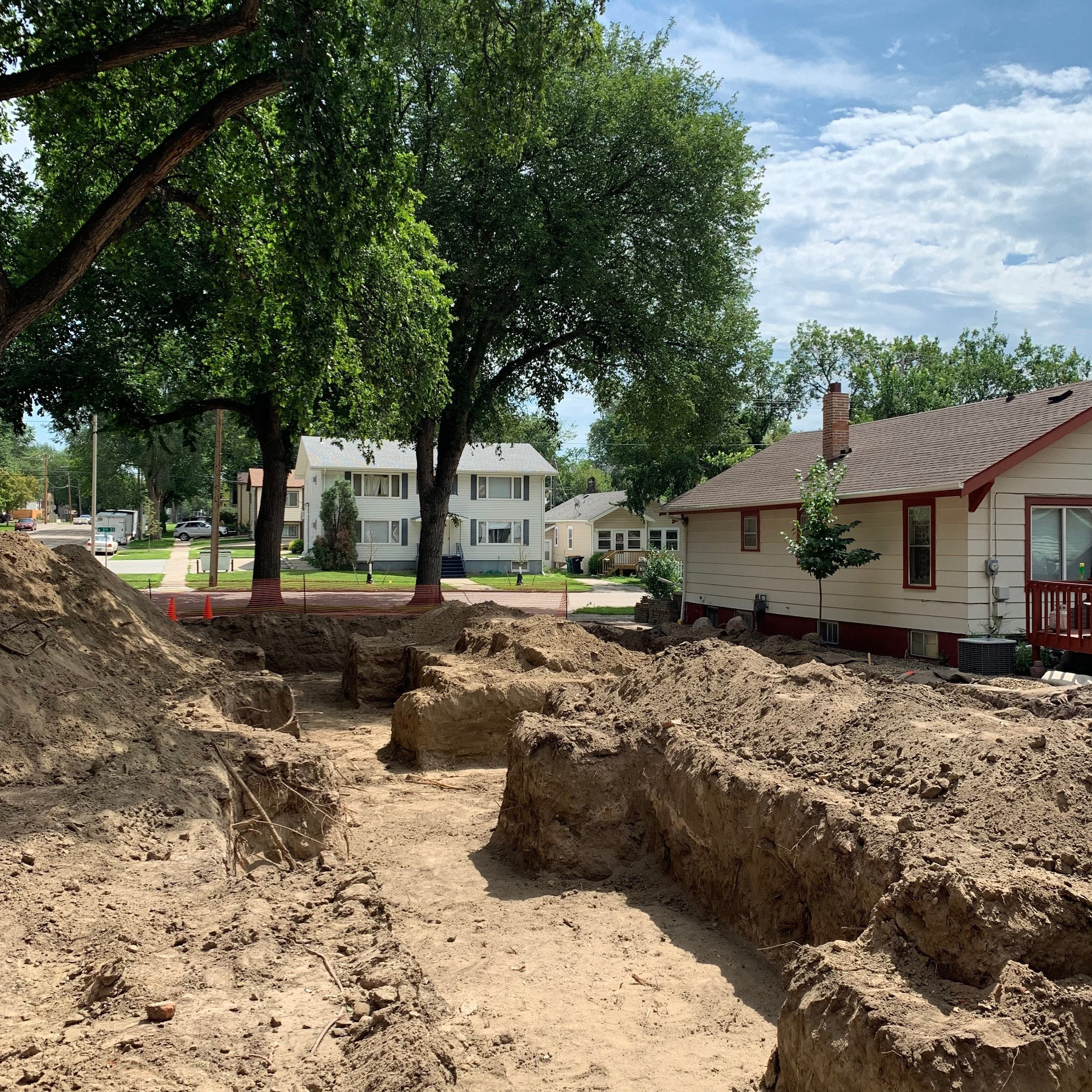 Establishing the proper elevation for the main floor was very important to us to ensure a comfortable main floor living space while still engaging the sidewalk. The site has some slope so we ended up stepping the units in the middle.