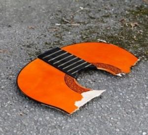 broken-guitar-e1280775565814.jpg