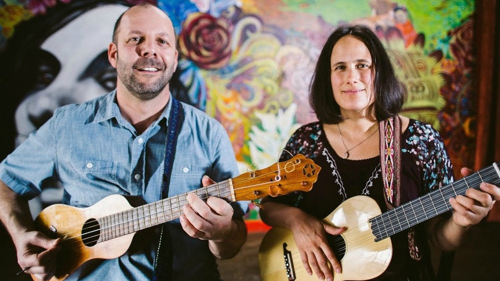 Estela Knott and David Berzonsky,  based in Charlottesville, VA are two very experienced and effective performers, teachers and community bridge builders who have a deep love, appreciation and understanding of a multitude of global folk musical traditions. They began their journey together performing with renowned Malian griot and  ngoni  master Cheick Hamala Diabate, and in their 19 years together have travelled and performed throughout North and South America, and have engaged in extensive study of folk music from Mexico, Peru, and Brazil, performing and recording with artists throughout the Americas. More recently, they run two organizations,  Blue Ridge Music Together,  which has worked with hundreds of Charlottesville area families teaching family oriented music classes, and  Luminaria Cville , which is a cultural arts project which hosts cultural events in collaboration with members of the local Spanish speaking community, including an annual  Dia de los Muertos  event and the  Cville Sabroso Festival . This past year's festival was the sixth year of the festival, and was in collaboration with WTJU and the IX Art Park with 3,500 people in attendance. The two perform together in their group  Lua , which is an original music ensemble that blends elements of Latin and Appalachian song traditions. David also plays upright bass with the acclaimed Gypsy jazz ensemble,  The Olivarez Trio.