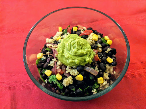 Vegetarian Bowl: Beans, spinach, quinoa, corn, peppers, onions & guacamole