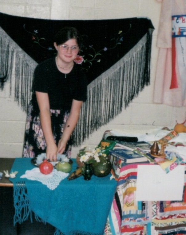 This is me at the 5th grade International Fair (hellllo 90s eye glasses) setting up a table about Cuba and passing out samples of Grandma's black beans.