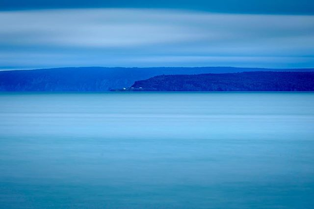 The New Brunswick coast from across the Bay of Fundy. I wanted to try playing with something very minimal with the haze, clouds and water all being very similar in tone. #hallsharbour #novascotia #longexposure #minimalism #fujifilm #fujifilmxt1