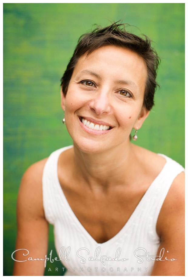 Portrait of woman on green background by Campbell Salgado Studio in Portland, Oregon.