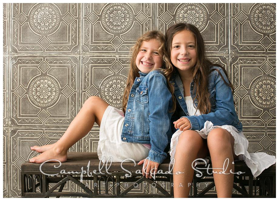 Portrait of girls on vintage tile background at Campbell Salgado Studio.