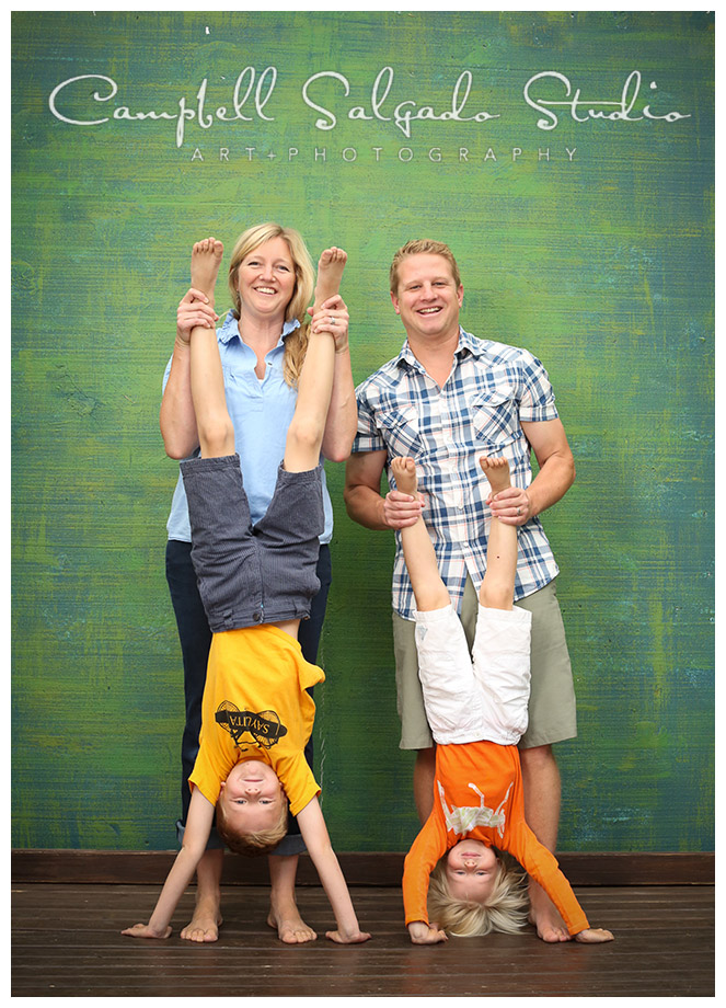 Portrait of family on green background by Campbell Salgado Studio.
