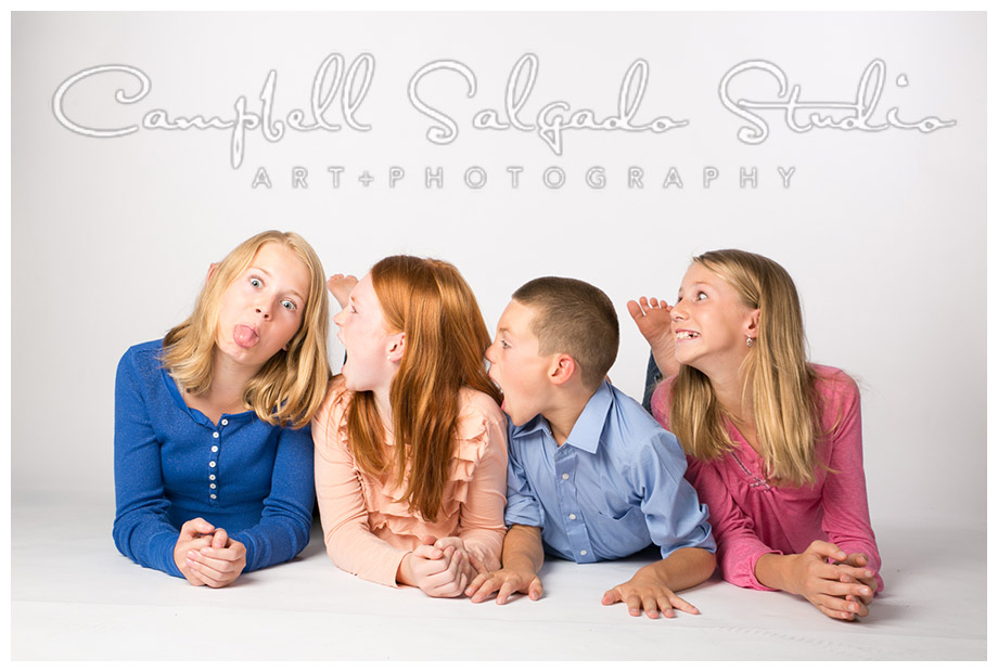 Portrait of siblings on white background by Portland photographers Campbell and Salgado.