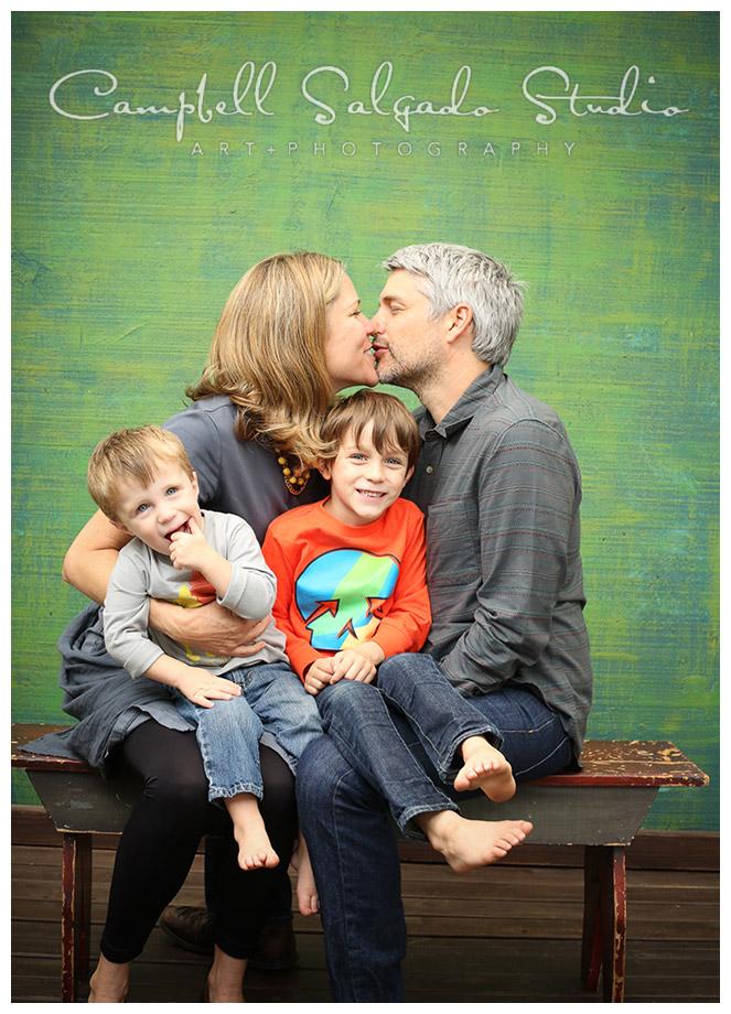 Portrait of family on green background by Campbell Salgado Studio in Portland, Oregon.