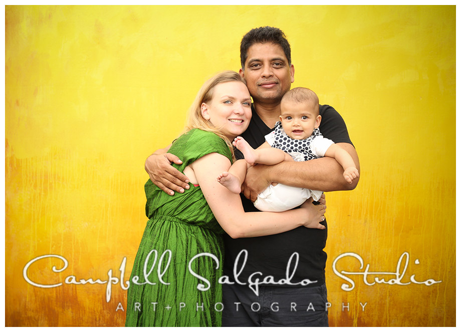 Portrait of family on yellow background by Portland photographers Campbell and Salgado.