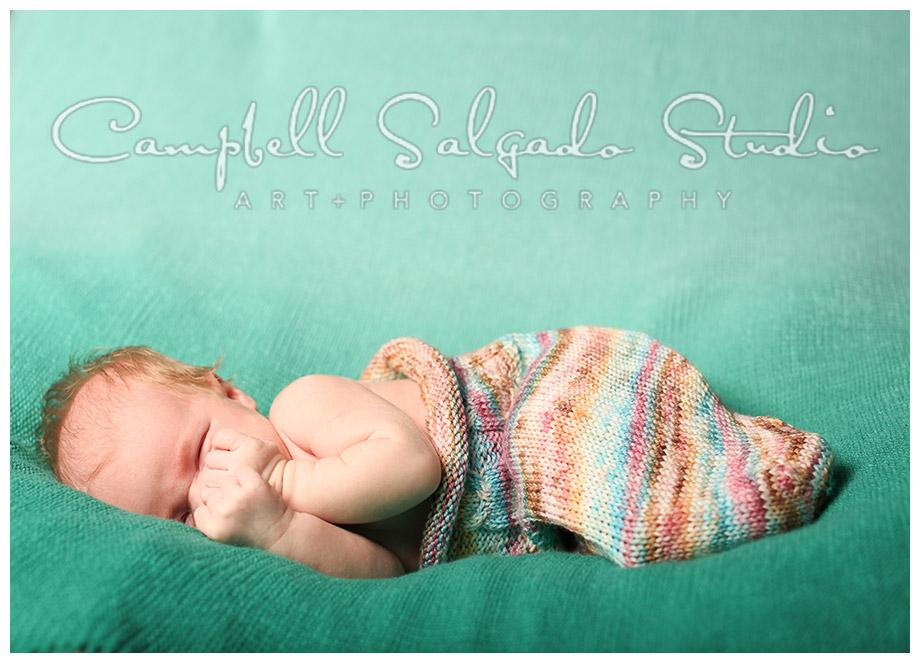 Portrait of infant on green hombre background at Campbell Salgado Studio.