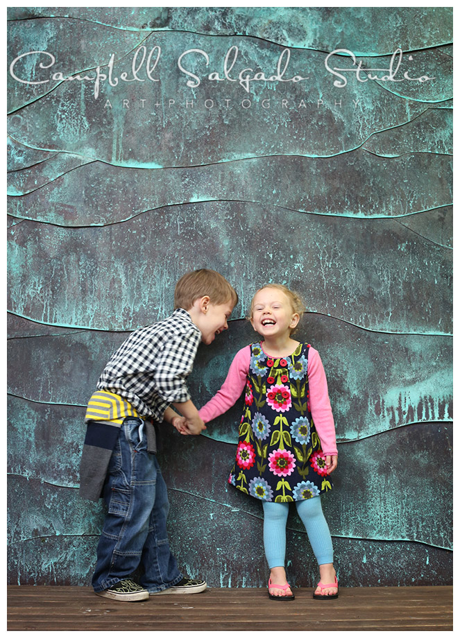 Portrait of siblings on copper background at Campbell Salgado Studio.