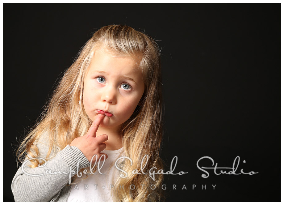 Portrait of young girl on black background at Campbell Salgado Studio.