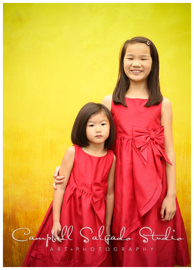 Portrait of girls on yellow background by photographers Campbell and Salgado.