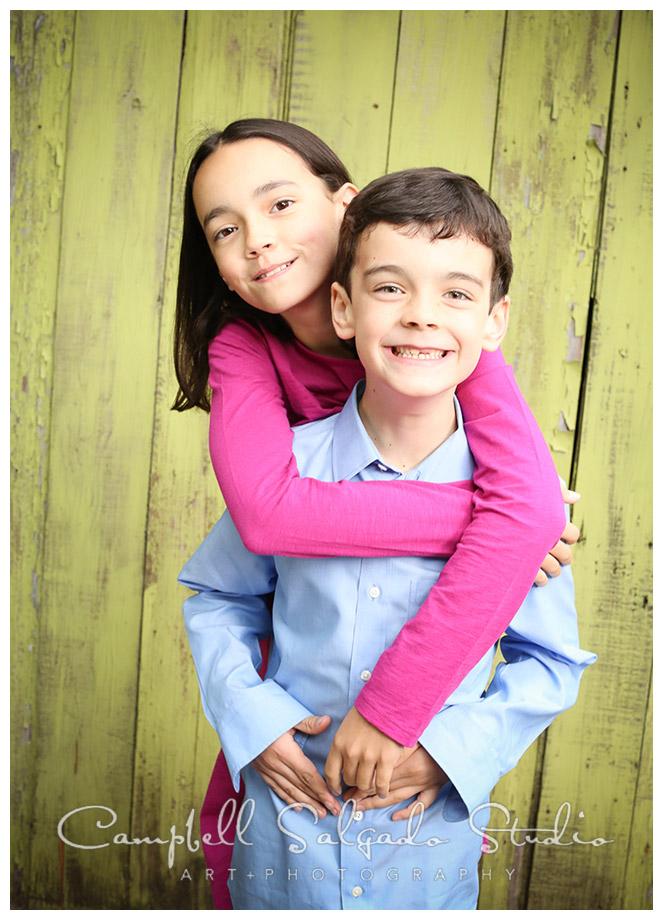 Portrait of children on green wooden background at Campbell Salgado Studio.