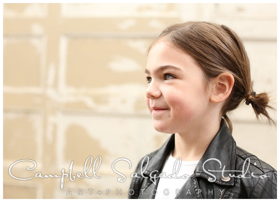 Portrait of young girl on vintage doors background at Campbell Salgado Studio.