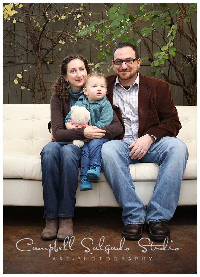 Portrait of family on white couch at Campbell Salgado Studio in Portland, Oregon.