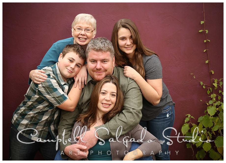 Portrait of family on plum background at Campbell Salgado Studio in Portland, Oregon.
