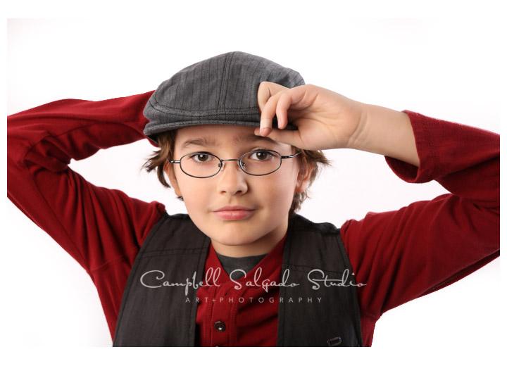 Portrait of boy on white background at Campbell Salgado Studio in Portland, Oregon.