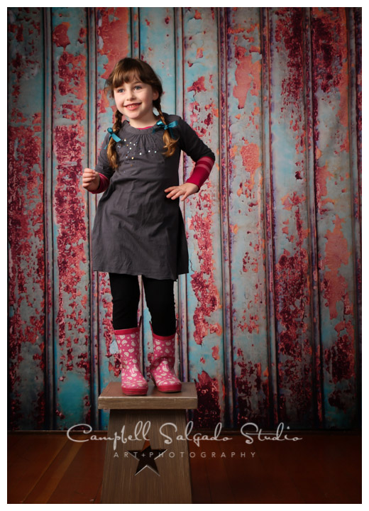 Portrait of young girl on Italian metal background by children's photographers at Campbell Salgado Studio.