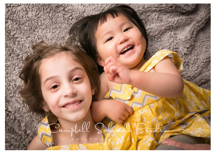 Portrait of girls on grey, fuzzy blanket at Campbell Salgado Studio.
