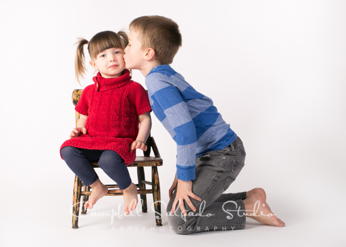 Portrait of siblings on white background at Campbell Salgado Studio In Portland, Oregon.