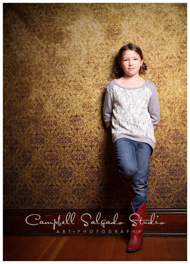 Portrait of girl in red boots on vintage amber background at Campbell Salgado Studio.