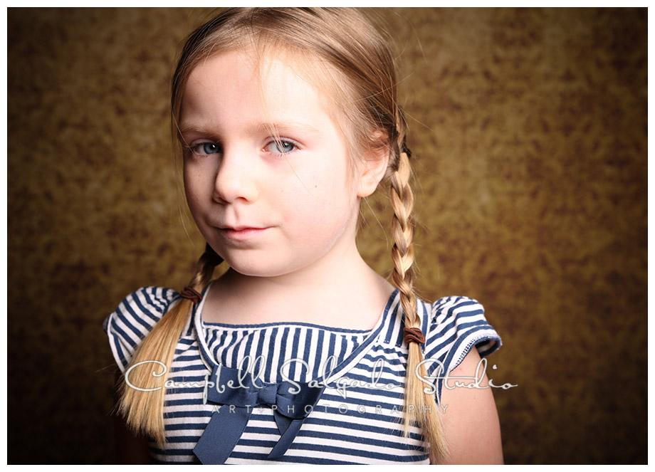 Portrait of girl on vintage, amber background at Campbell Salgado Studio.