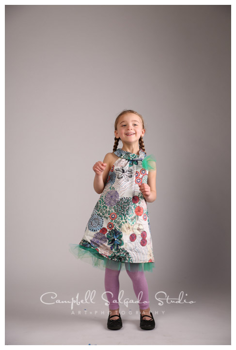 Portrait of little girl on grey background at Campbell Salgado Studio.