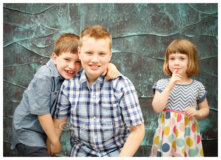 Portrait of children on copper background at Campbell Salgado Studio.