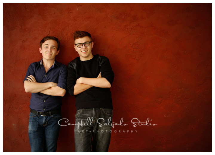 Portrait of boys on red stucco background at Campbell Salgado Studio.