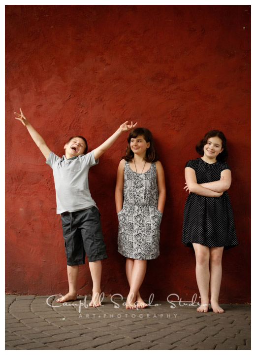 Portrait of children on red stucco background at Campbell Salgado Studio.