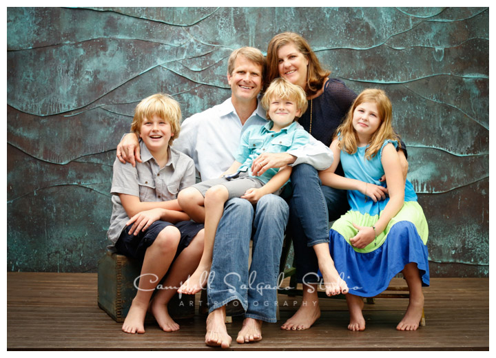 Portrait of family on copper background at Campbell Salgado Studio.