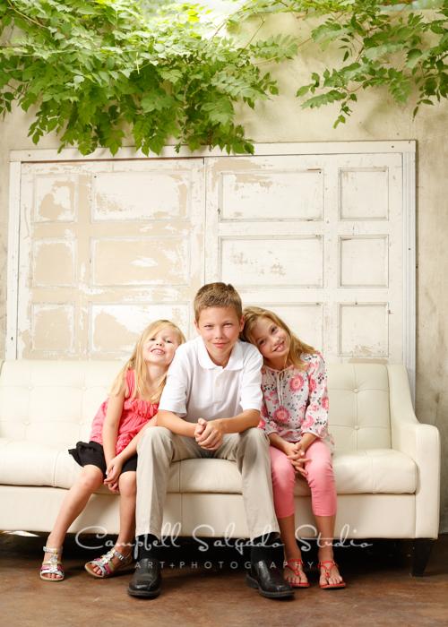 Portrait of siblings on vintage white doors at Campbell Salgado Studio.