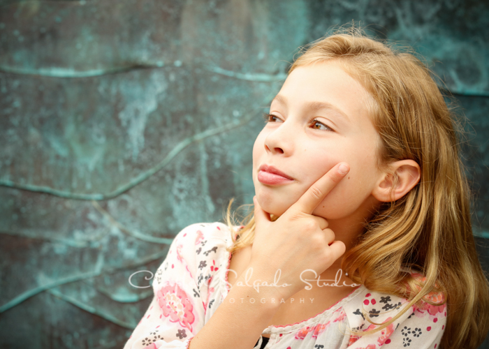 Portrait of girl on copper background at Campbell Salgado Studio.