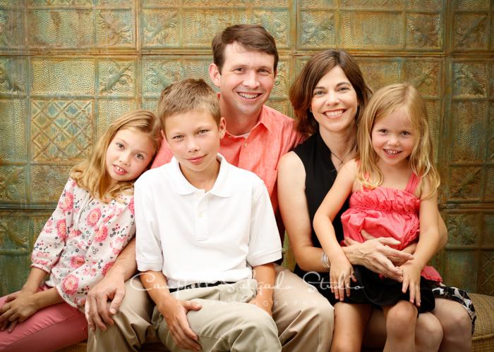 Portrait of family on tin background at Campbell Salgado Studio.