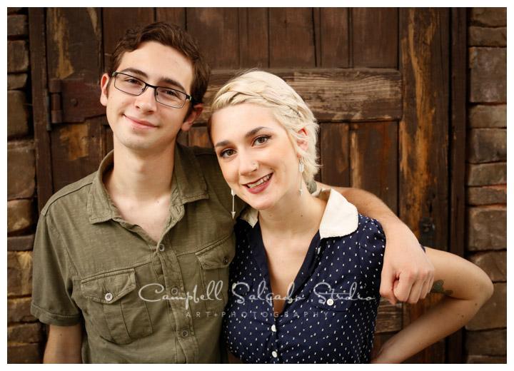 Portrait of siblings on rustic door background at Campbell Salgado Studio.