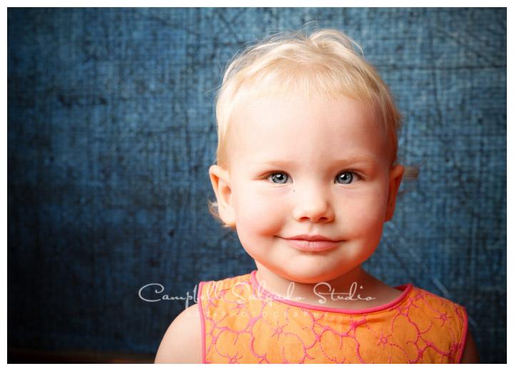 Portrait of little girl on denim background at Campbell Salgado Studio.