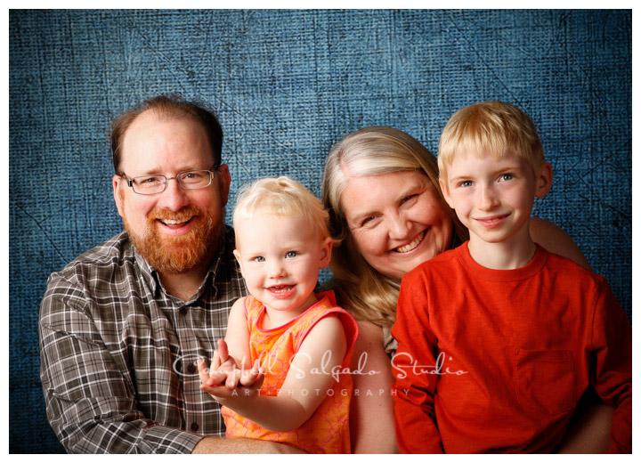 Portrait of family on denim background at Campbell Salgado Studio.