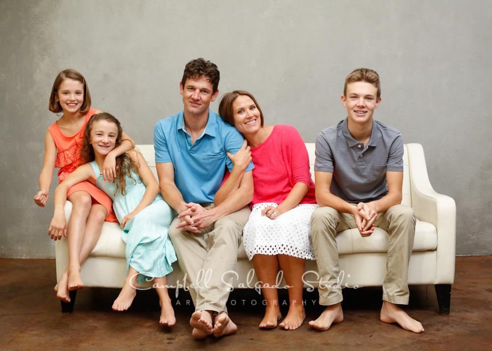 Portrait of family on modern grey backgroundby family photographers at Campbell Salgado Studio, Portland, Oregon.
