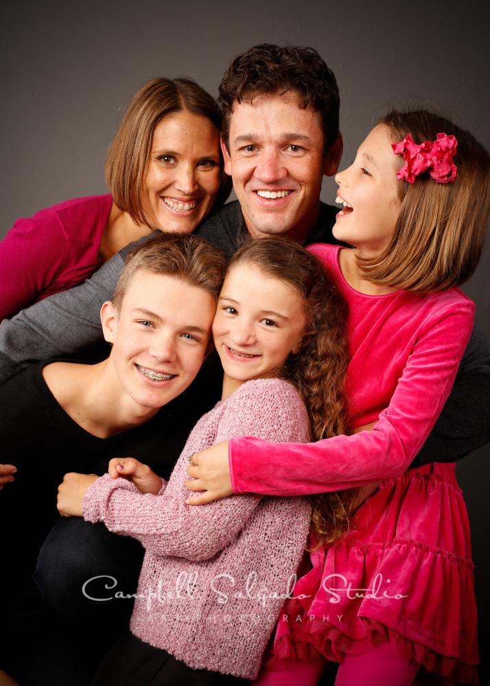 Portrait of family on grey background by family photographers at Campbell Salgado Studio, Portland, Oregon.