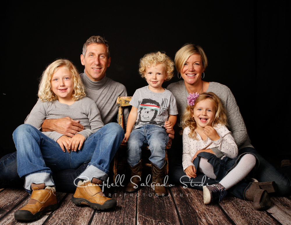 Portrait of family on black background by family photographers at Campbell Salgado Studio, Portland, Oregon.